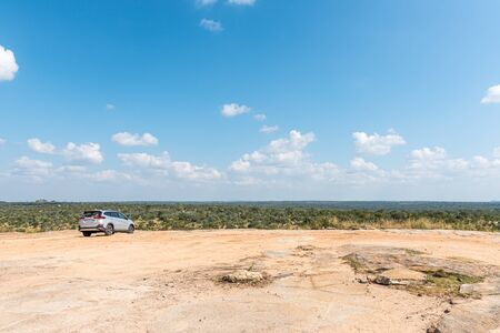 KRUGER NATIONAL PARK, SOUTH AFRICA - MAY 5, 2019: The Mathekenyane Viewpoint on top of a hill.  A vehicle is visible