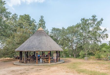 KRUGER NATIONAL PARK, SOUTH AFRICA - MAY 5, 2019: Picnic area at the Afsaal Picnic Site in the Kruger National Park. People are visible Redakční