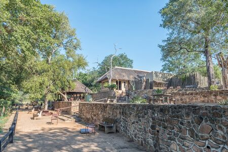 KRUGER NATIONAL PARK, SOUTH AFRICA - MAY 4, 2019: A view of the Nkuhlu Picnic Site and the Sabie River in the Kruger National Park. Benches are visible
