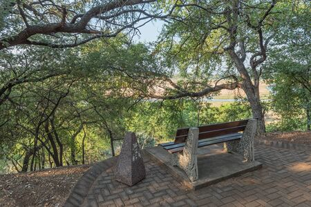 KRUGER NATIONAL PARK, SOUTH AFRICA - MAY 7, 2019: A shaded viewpoint in the Letaba Rest Camp next to the Letaba River Editorial