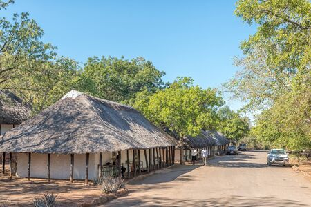 KRUGER NATIONAL PARK, SOUTH AFRICA - MAY 15, 2019: Bungalows in the Punda Maria Rest Camp. People and vehicles are visible