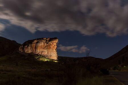 The Brandwag Buttress at night, lit by floodlights, in Golden Gate in the Free State Province
