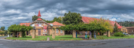 FICKSBURG, SOUTH AFRICA - MARCH 20, 2020: A panoramic street scene, with the General Jan Fick museum, the town hall and people, in Ficksburg Sajtókép