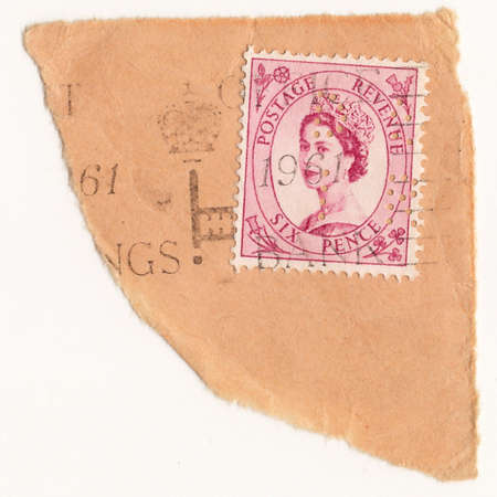 constitutional: UK CIRCA 1950: A stamp printed in United Kingdom shows image of Elizabeth II is the constitutional monarch of United Kingdom Editorial