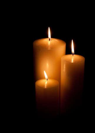 Three candles burning Фото со стока - 9203977