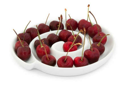 Bowl of Cherries on white background Stock Photo