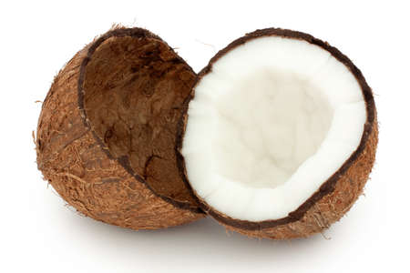 Coconut halves on white background one half with the flesh scooped out