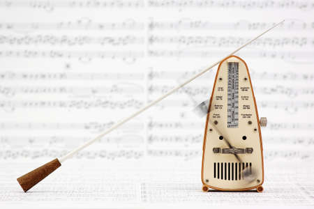 Metronome and Baton Stock Photo - 11799641