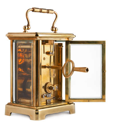 mantle: Antique Carriage Clock with rear door open showing key Stock Photo