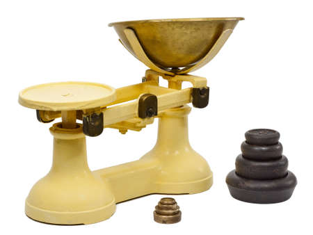 Traditional balance kitchen scales with weights isolated on a white background photo