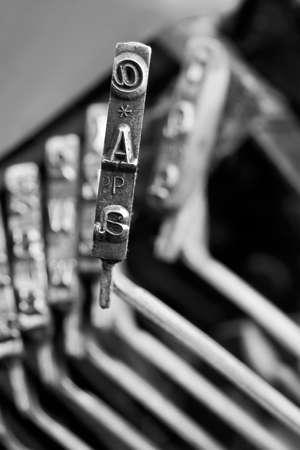 Close-up of Single Typewriter typebar A and @ Stock Photo - 14397486