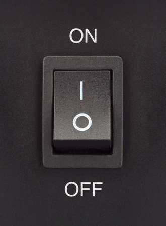 Black toggle switch on black surface - on off Stock Photo - 14453438