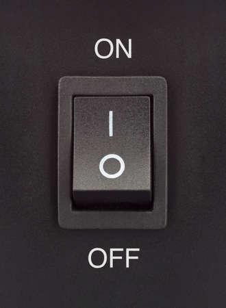 Noir interrupteur � bascule sur une surface noire - on off Banque d'images
