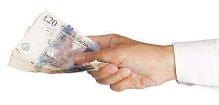 ManÕs Hand holding £300 in twenty pound notes Stock Photo