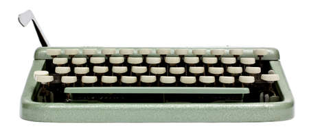 Typewriter shot from low angle with the carriage return sticking up on the left. Isolated on white background