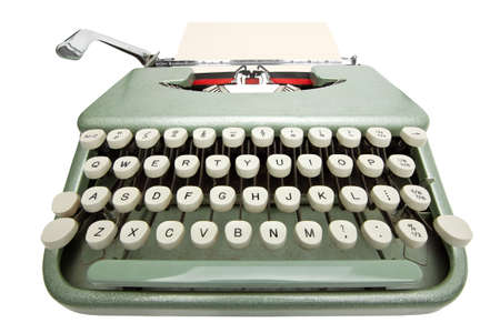 Wide angle shot of typewriter with sheet of paper. Isolated on white background  Stock Photo