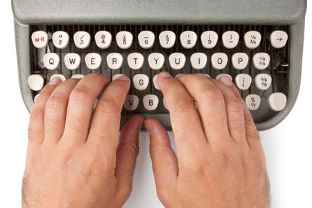 Hands on a typewriter keyboard on a white background Stock Photo