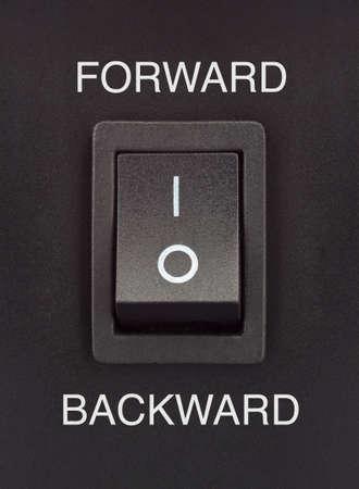 forward or backward black toggle switch on black surface positive negative Stock Photo - 16842329