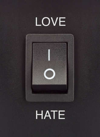 Love or Hate black toggle switch on black surface positive negative Stock Photo