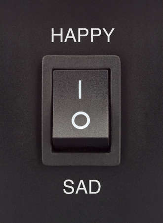 Happy or Sad black toggle switch on black surface positive negative Stock Photo - 16842327