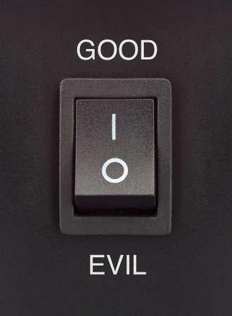Good or Evil black toggle switch on black surface positive negative Stock Photo - 16842330