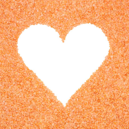 Frame made of lentils in the shape of a heart with clipping path photo