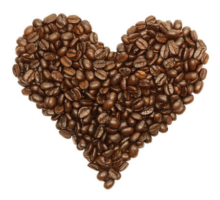 Coffee beans in the shape of a heart isolated on white with a clipping path Stock Photo