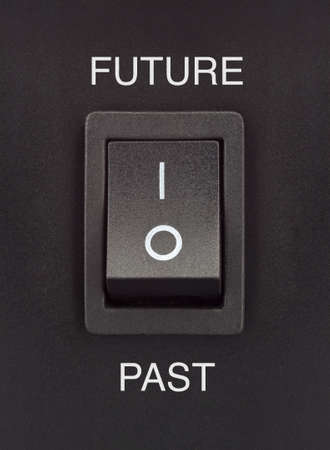 Future or past black toggle switch on black surface positive negative
