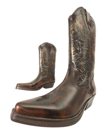 Paire de bottes de cow-boy tir� grand angle, isol� sur blanc avec chemin de d�tourage