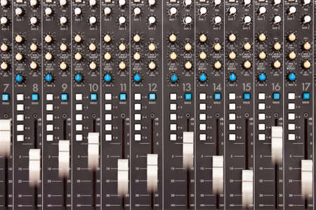 Moving faders on a mixing desk - motion blur Stock Photo