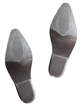 feet soles: Pair of cowboy boot soles isolated on white with clipping path