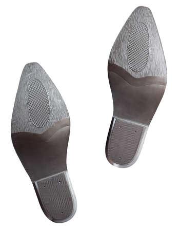 huellas pies: Un par de suelas de las botas de vaquero aislado en blanco con trazado de recorte