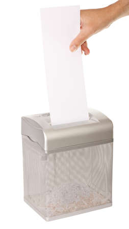 paper shredder: Hand feeding a piece of paper into a document shredder - room for copy. Isolated on white with clipping path.
