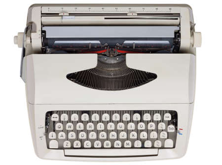 Typewriter keyboard shot from above  Black text on white keys  Isolated on white with clipping path
