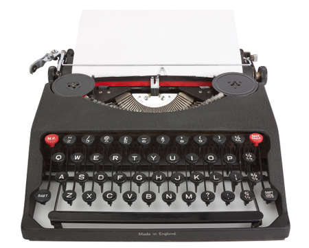 Typewriter with sheet of paper isolated on white background with clipping path photo