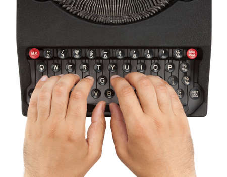 Hands on a typewriter keyboard with a white background Stock Photo