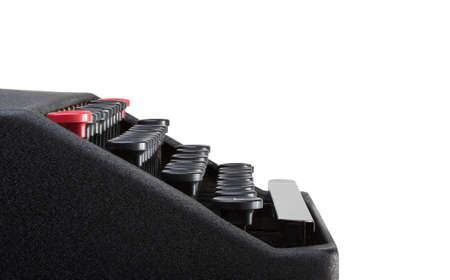 Side view of typewriter keyboard with a white background and clipping path. Plenty of space for copy. Stock Photo