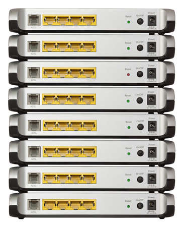 Stack of eight ADSL modems, isolated on white with  photo