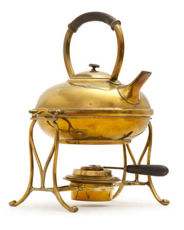 Old brass kettle with methylated spirit burner, on white with a soft shadow.