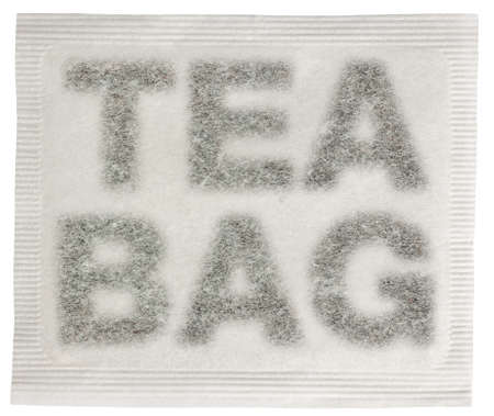 Square tea bag with tea in the shape of a the words tea bag isolated on white