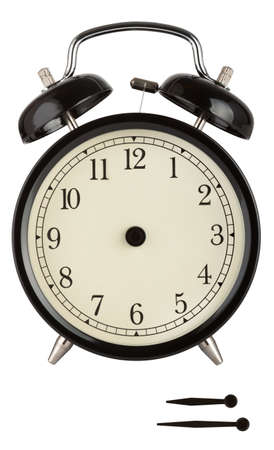 Traditional alarm clock with black face and separate hands to show anytime isolated on white