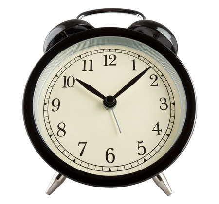 Wide angle shot of a traditional alarm clock isolated on white