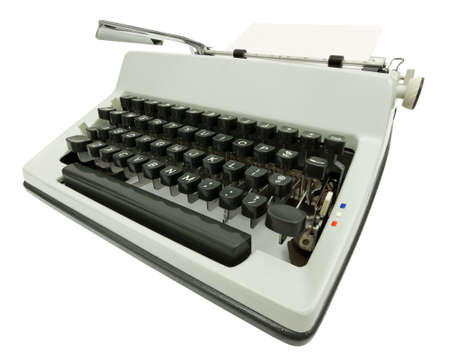 Wide angle side view of typewriter on white