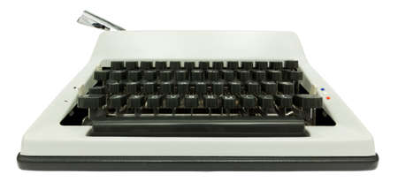 Wide angle front view of typewriter on white