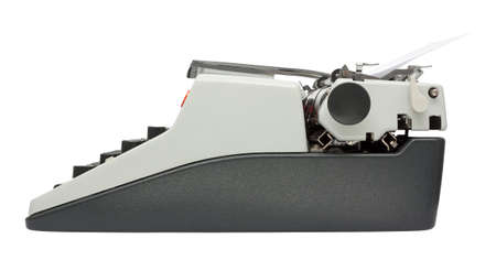 Side view of typewriter isolated on white background with clipping path