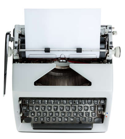 Typewriter keyboard shot from above. White text on black keys. Isolated on white with clipping path