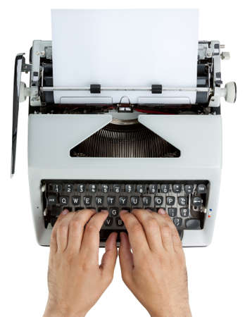 Hands on typewriter keyboard shot from above. White text on black keys. Isolated on white with clipping path