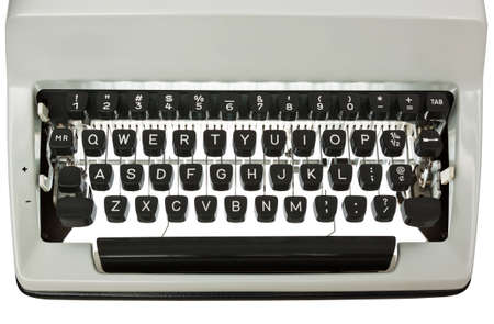 Backlit Typewriter keyboard. White text on black keys. Isolated on white with clipping path Stock Photo