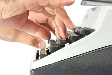 Side view of hands on a typewriter keyboard with a white background