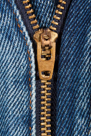 Close up of denim jeans zip partly open